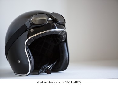 motorbike classic helmet with traditional glasses for protection.