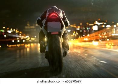 Motorbike drives through night city