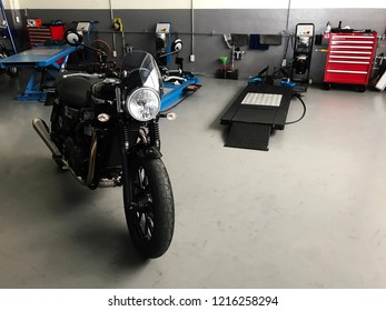 Motorbike garage in Phitsanulok, Thailand - October 27, 2018 : Triumph street twin model 2017 modern classic design motorcycle parking in garage for maintenance checks and service.