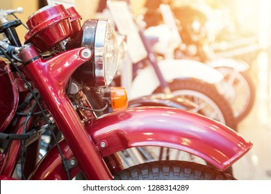 Motorbike, motorcycle parked in row in city street. Close up of wheel. Row of many motorcycle at the showroom for sale