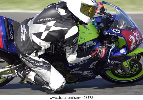 Motorbike Racing event at Portugal. A fast corner makes pilots pull out their maximum capabilities.