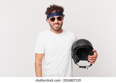 motorbike rider feeling puzzled and confused, with a dumb, stunned expression looking at something unexpected