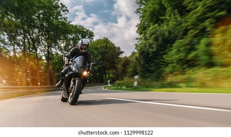 motorbike riding on the road at summer. driving on the empty road
