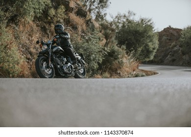 Motorbike turning on a mountain road.