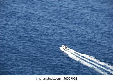 Motorboat crossing ocean