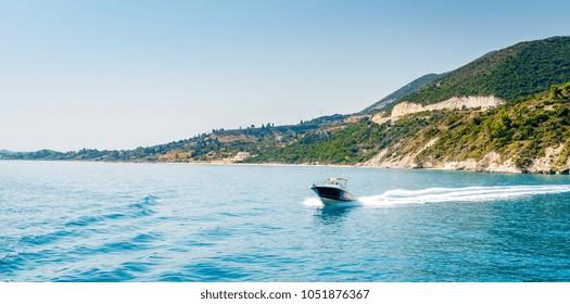 Motorboat driving on Ionian sea near Zakynthos island, Greece