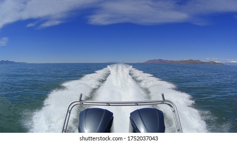 Motorboat with dual outboard engines powers across the Great Salt Lake in Utah