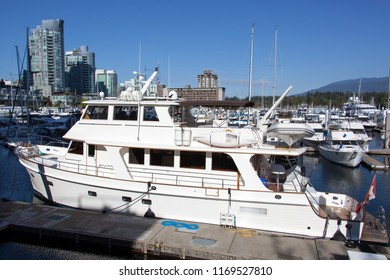The motorboat inside Coal Harbour district marina in Vancouver downtown (British Columbia).