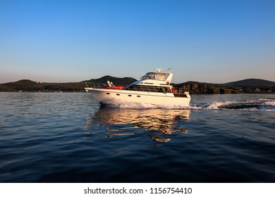 Motorboat moving in the sea at sunset