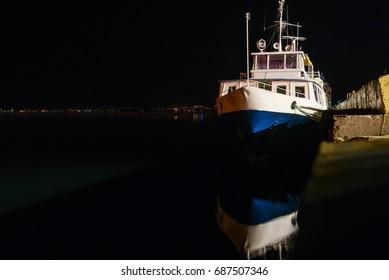 Motorboat at night port