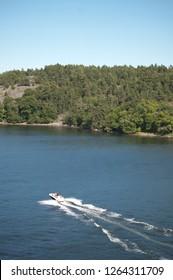 Motorboat on a Blue Lake