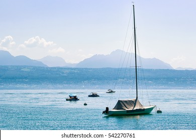 Motorboat on Lake Geneva in Lausanne, Switzerland. Alps on the background