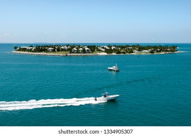 The motorboat passing by an artificial residential island Sunset Key (Key West, Florida).