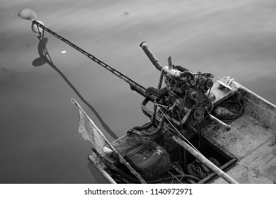 A motorboat, speedboat, or powerboat is a boat which is powered by an engine. This motorboat is fitted with outboard engine on the rear. This picture is in black and white color.