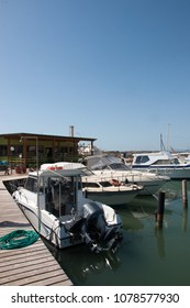 Motorboats moored at the pier