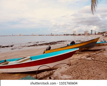 Motorboats resting on the Mexican Pacific coast; the proverbial siesta. These watercraft shuttle tourists and locals to isolated parts of the Sinaloa shore, and to haul in seafood for market trade.