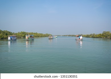 Motorboats sailing through delta of Sundarban, the largest delta in the world. Sundarban is the home of Royal Bengal Tigers.