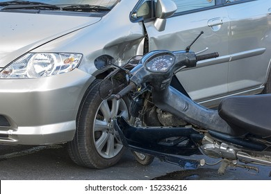 Motorcycle accident with a car., car accident
