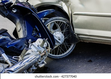 Motorcycle accident with a car.