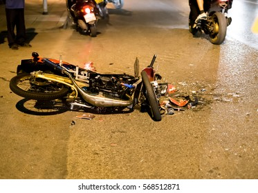 Motorcycle accident on road at night