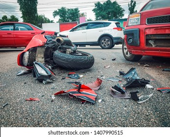 Motorcycle bike accident and car crash, broken and wrecked moto on road