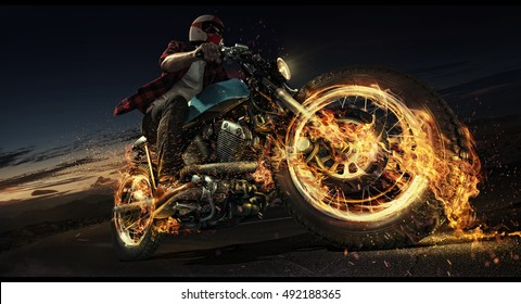 Motorcycle. Biker riding motorcycle on an empty road at the night. Fire and energy