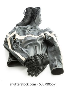 Motorcycle boots, jacket and gloves isolated on white background.