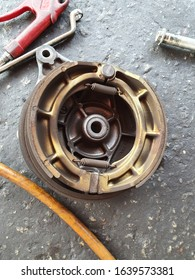 motorcycle brake shoe on the floor of a workshop