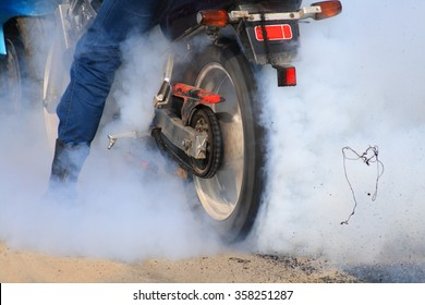 Motorcycle burning out.