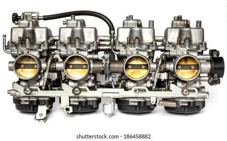 Motorcycle carburetor isolated on the white background, engine part, four cylinder