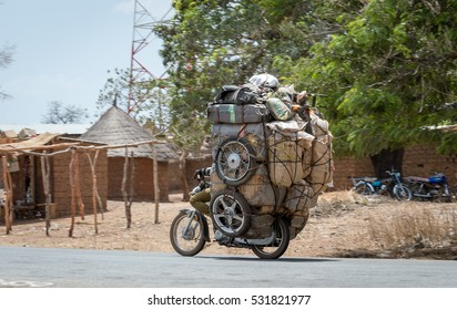 Motorcycle carrying a lot of stuff overloaded, Cameroon Africa.