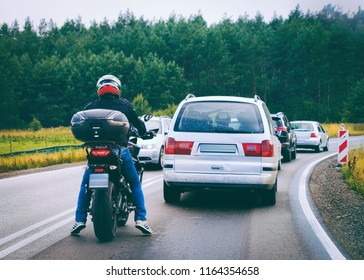 Motorcycle and cars in a traffic jam on the road in Poland