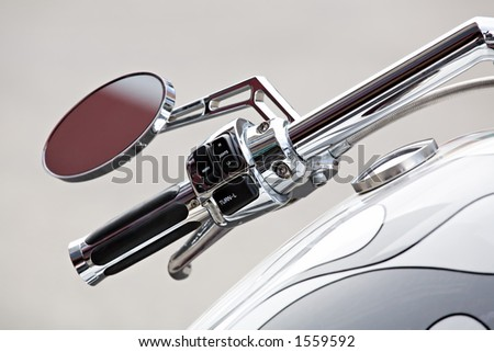 motorcycle - chopper details, handlebar and gas tank closeup, shallow depth of field with focus on switches