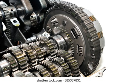 Motorcycle clutch with drive chain and gears in front.