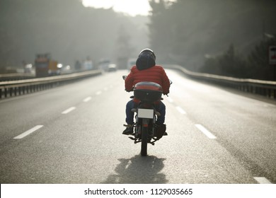 Motorcycle Courier On The Road