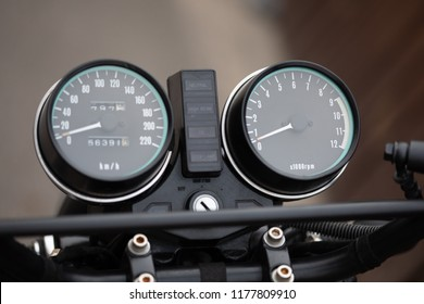Motorcycle dash display instruments with speedometer and tachometer