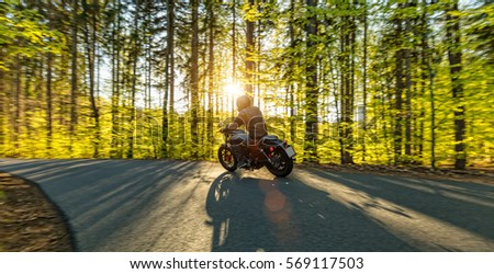 Motorcycle driver driving in