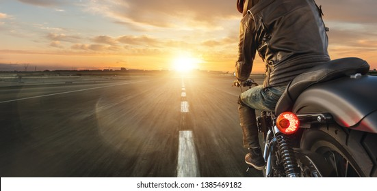 Motorcycle driver riding alone on asphalt motorway. Outdoor photography. Travel and sport, speed and freedom concept
