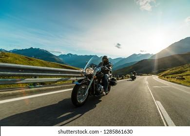 Motorcycle driver riding in Alpine highway, Hochalpenstrasse, Austria, central Europe.