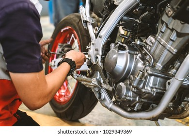 motorcycle engine repair with soft-focus and over light in the background
