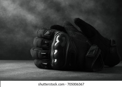 Motorcycle gloves on wooden background,with copy space -vintage effect.