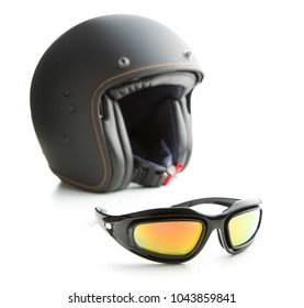 Motorcycle goggles and helmet isolated on white background.