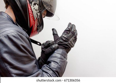 Motorcycle Guy Wearing Helmet and Leather Jacket Gearing Up
