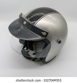 Motorcycle helmet in grey and black color isolate on white background