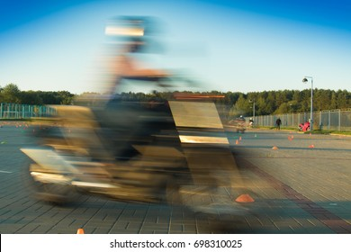 Motorcycle at high speed, background texture blur