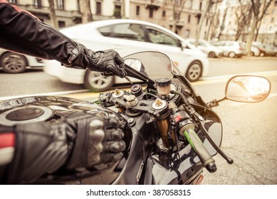 Motorcycle ignition. Biker starting his motorcycle up. Concept about transportation