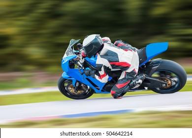 motorcycle racing images stock photos vectors shutterstock. Black Bedroom Furniture Sets. Home Design Ideas