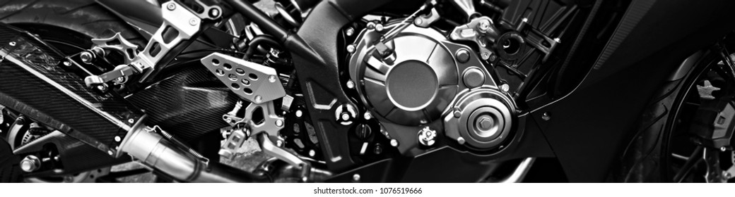 Motorcycle, metal and chrome engine parts in closeup.