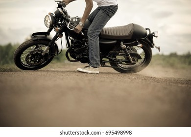 Motorcycle or motorbike spot with male rider.