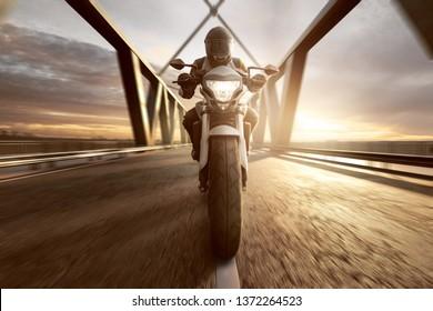 Motorcycle on a Bridge at sunset